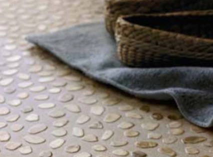 Close up of patterned flooring with a towel on the floor