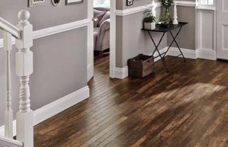 Grey room with dark wooden flooring
