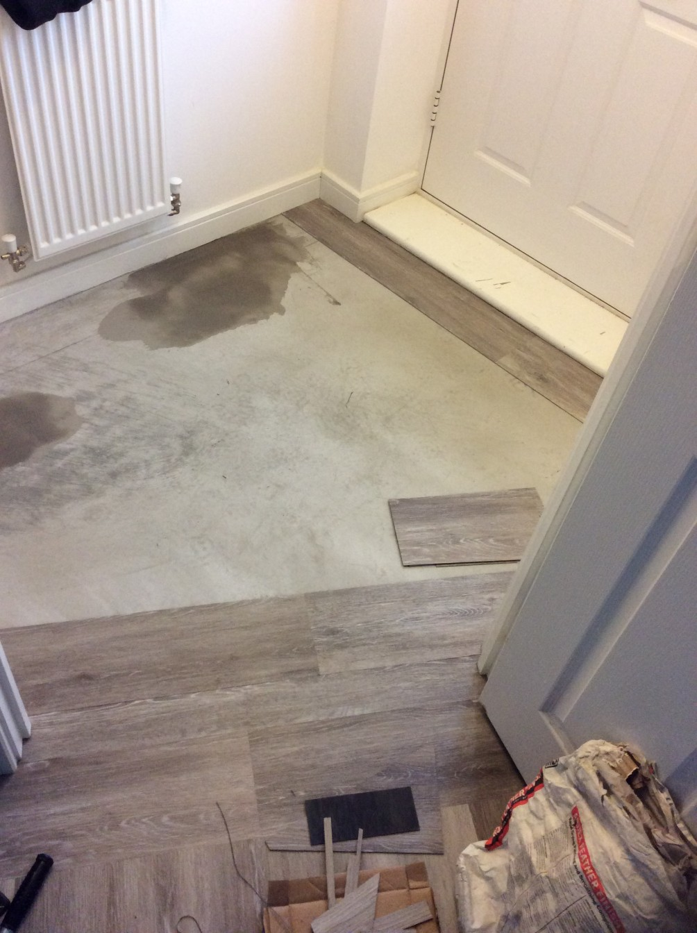 Entranceway with grey wooden flooring half placed