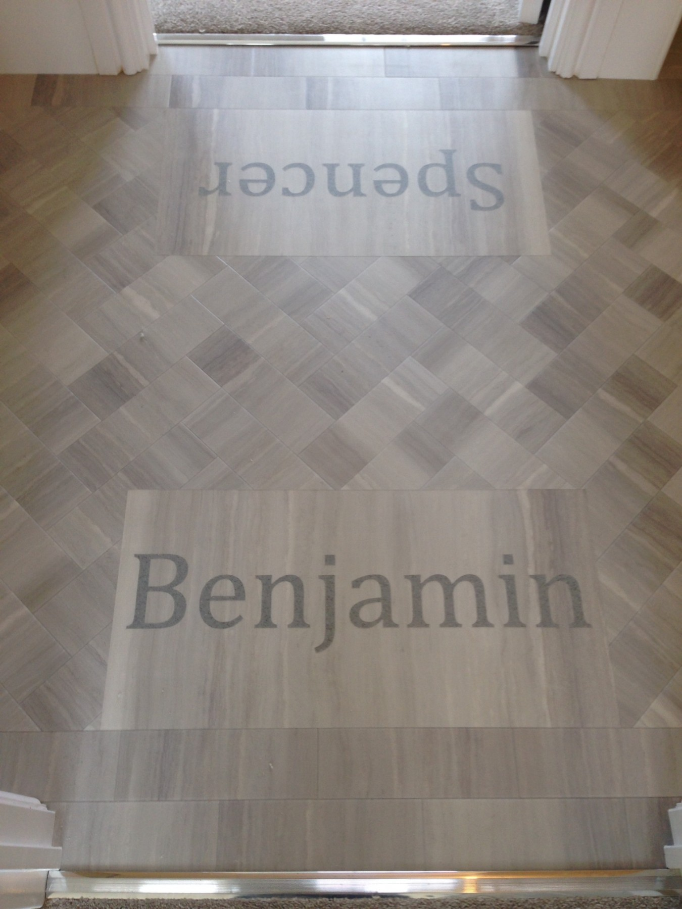 Patterned wooden flooring with the words Benjamin and Spencer overlayed