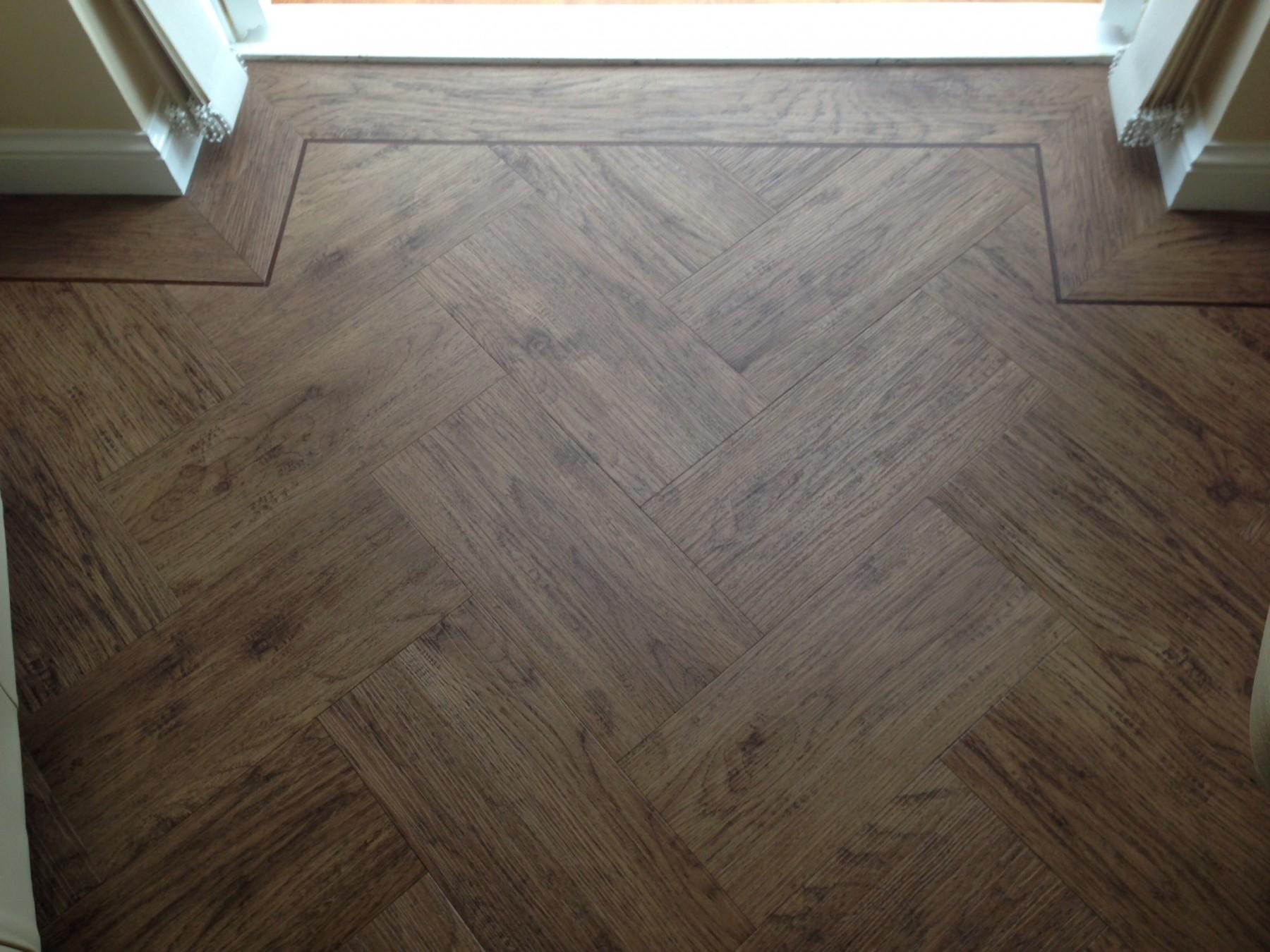 Dark chevroned wooden flooring