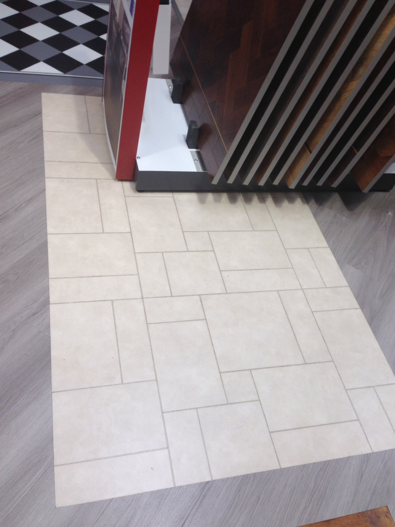 Flooring showroom with stacked tiles with a grey and cream flooring down