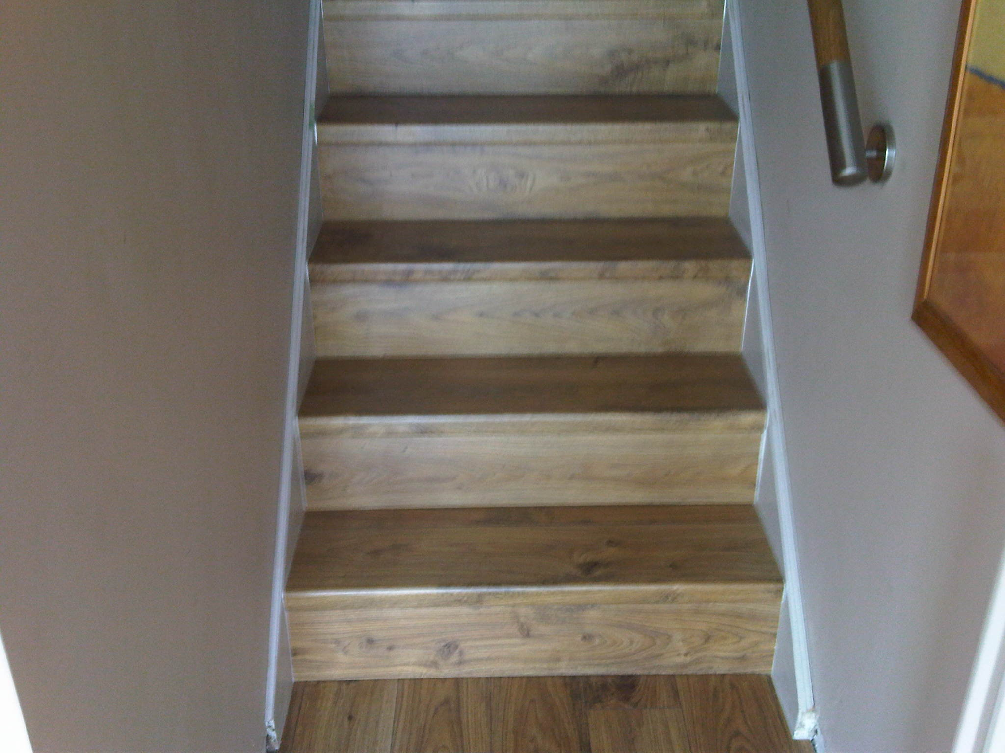 Beige staircase with wooden stairs