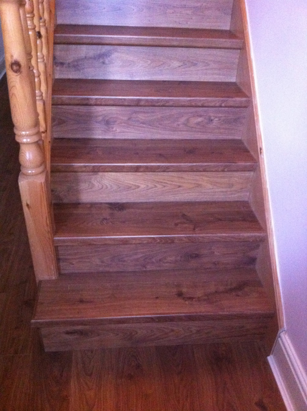 Pale pink staircase with wooden stairs and flooring
