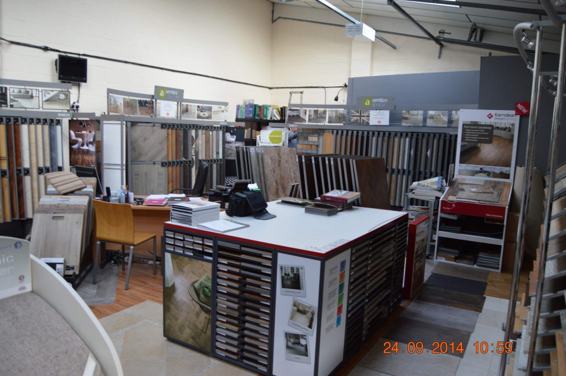 Large flooring showroom with many different displays