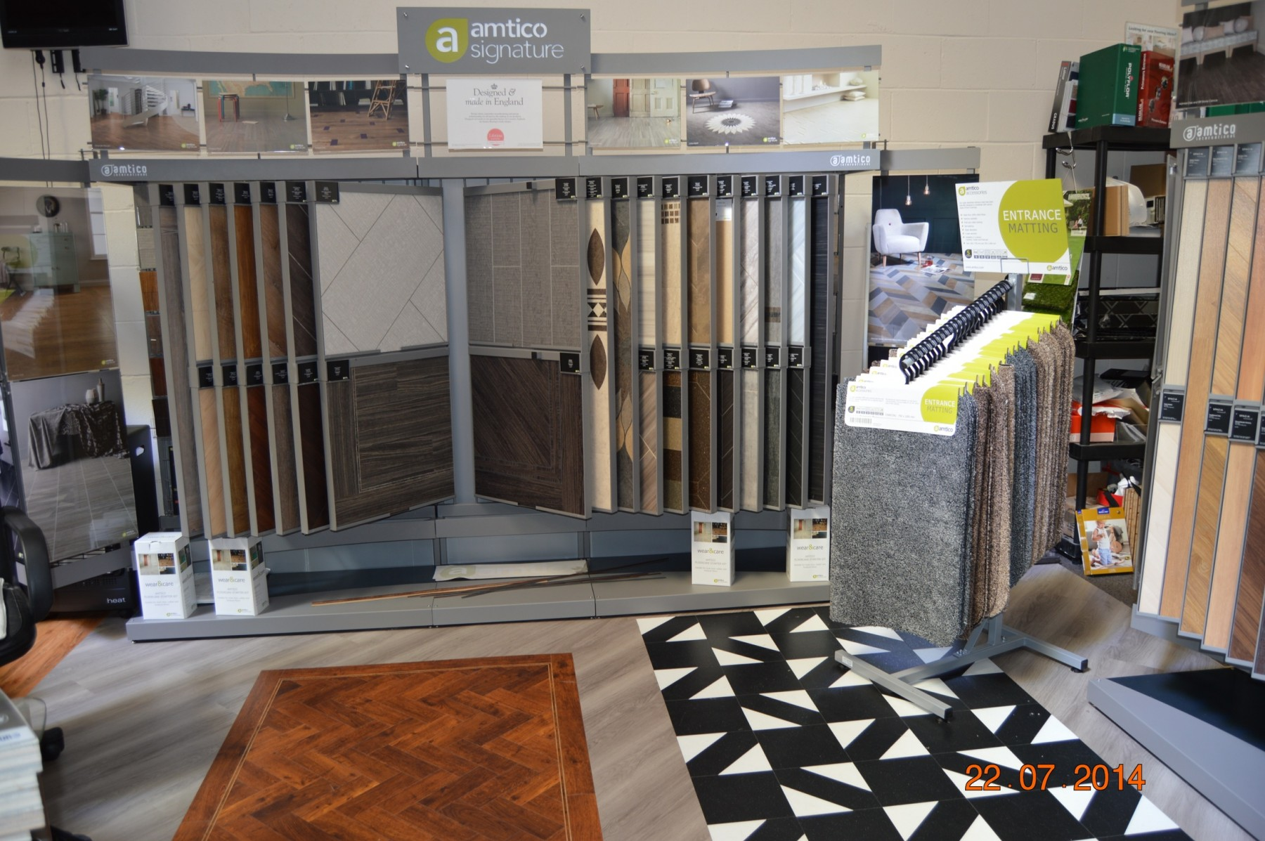Flooring showroom showing a display of carpets and tiles